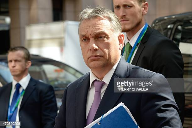 Hungary's Prime minister Viktor Orban arrives at the European Council headquarters for an extraordinary summit of European leaders to deal with a...
