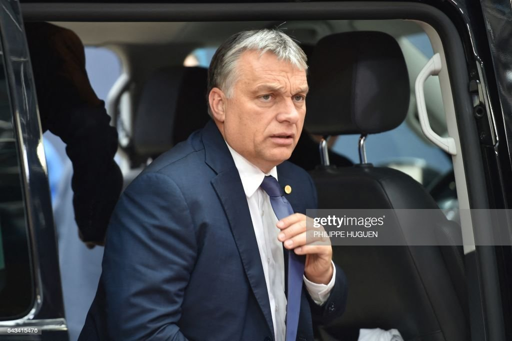 Hungary's Prime minister Viktor Orban arrives before an EU summit meeting on June 28, 2016 at the European Union headquarters in Brussels. / AFP / PHILIPPE