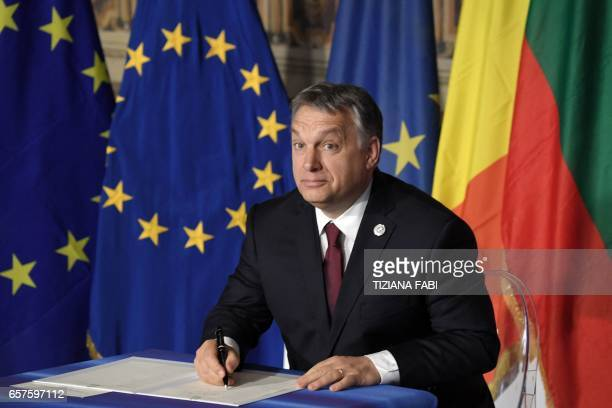 Hungary's prime Minister Viktor Orban signs the new Rome declaration with leaders of 27 European Union countries special during a summit of EU...
