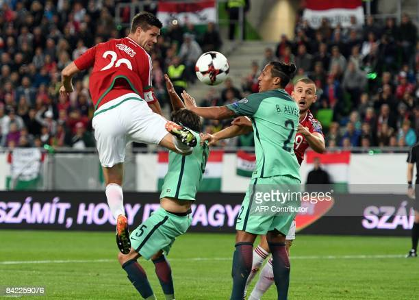 Hungary's Richard Guzmics vies with Portugal's Fabio Coentrao during the FIFA World Cup 2018 qualification football match between Hungary and...
