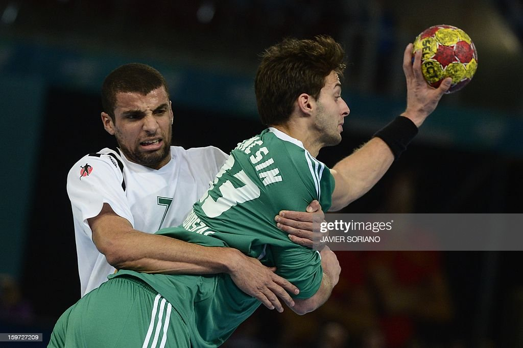 Hungary's right back Gabor Ancsin (R) vies with Algeria's centre back Hichem Daoud during the 23rd Men's Handball World Championships preliminary round Group D match Hungary vs Algeria at the Caja Magica in Madrid on January 19, 2013. AFP PHOTO/ JAVIER SORIANO