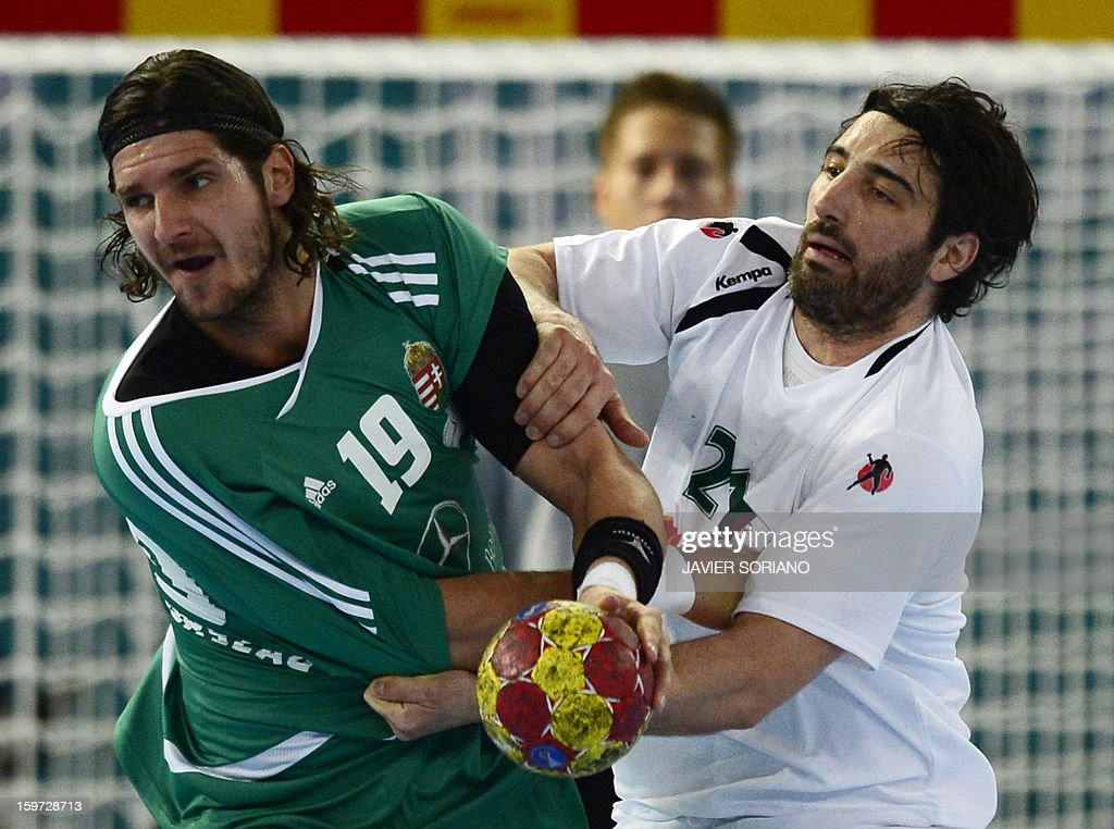 Hungary's right back Laszlo Nagy (L) vies with Algeria's pivot Mohamed Aski Mokrani during the 23rd Men's Handball World Championships preliminary round Group D match Hungary vs Algeria at the Caja Magica in Madrid on January 19, 2013. Hungary won 29-25.