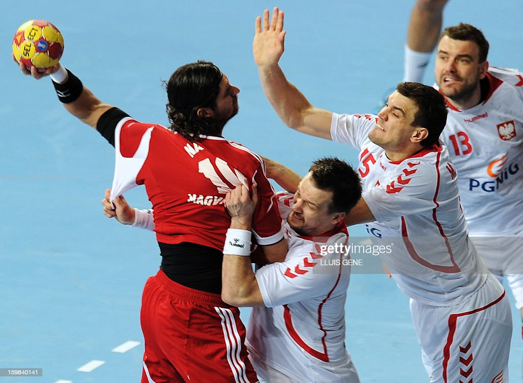Hungary's right back Laszlo Nagy (L) vies with Poland's centre back Michal Kubisztal (2-RL, Poland's left back Michal Jurecki (2nd R) and Poland's pivot Bartosz Jurecki (R) during the 23rd Men's Handball World Championships round of 16 match Hungary vs Poland at the Palau Sant Jordi in Barcelona on January 21, 2013. AFP PHOTO/ LLUIS GENE