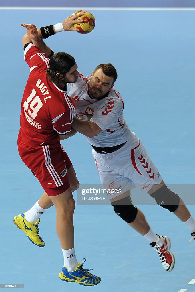 Hungary's right back Laszlo Nagy (L) vies with Poland's pivot Bartosz Jurecki (R) during the 23rd Men's Handball World Championships round of 16 match Hungary vs Poland at the Palau Sant Jordi in Barcelona on January 21, 2013.