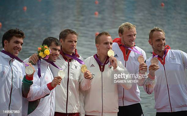 Hungary's Rudolf Dombi and Roland Kokeny Portugal's Fernando Pimenta and Emanuel Silva and Germany's Martin Hollstein and Andreas Ihle pose on the...