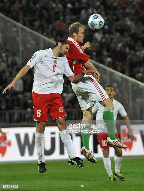 Hungary's Sandor Torghelle heads the ball with Malta's Jonathan Carvana during their World Cup 2010 qualification match at Puskas stadium of Budapest...