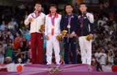 Hungary's silver medalist Miklos Ungvari Georgia's gold medalist Lasha Shavdatuashvili Japan's bronze medalist Masashi Ebinuma and Korea's bronze...