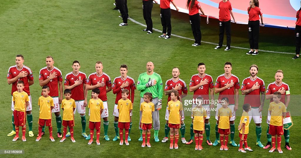 Hungary's starting eleven sing their national anthem during the Euro 2016 round of 16 football match between Hungary and Belgium at the Stadium Municipal in Toulouse on June 26, 2016. / AFP / Pascal PAVANI
