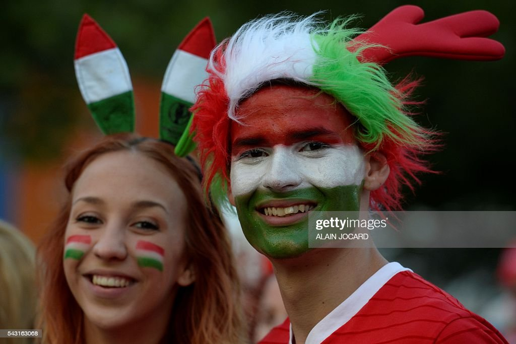 Hungary's supporters react as they watch on a giant screen the Euro 2016 round of 16 football match between Hungary and Belgium at the Champs-de-Mars fan zone in Paris on June 26, 2016. / AFP / ALAIN