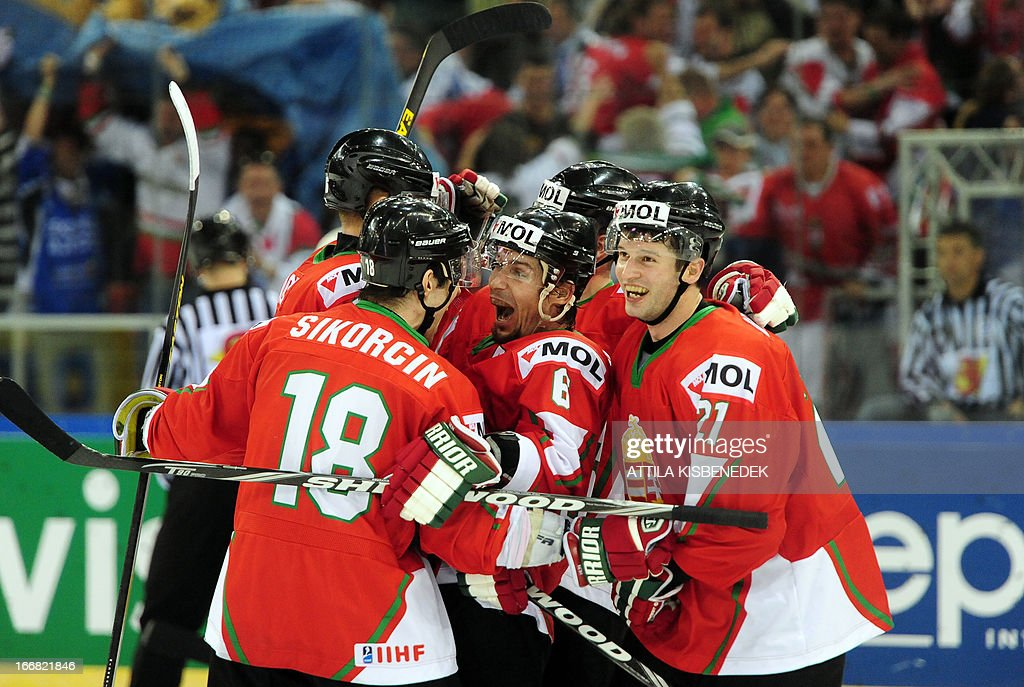 Hungary's Viktor Tokaji (C) celebrates scoring the winning goal with his teammates during the 2013 IIHF Ice Hockey World Championship Division I Group A match Kazakhstan vs Hungary in 'Papp Laszlo' Arena of Budapest on April 17, 2013. Hungarians won 2-1.