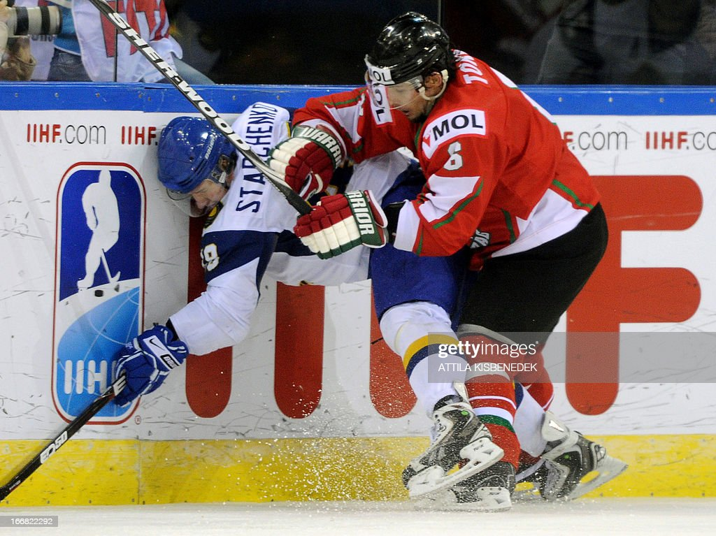Hungary's Viktor Tokaji (R) vies with Kazakhstan's Roman Starchenko (L) during the 2013 IIHF Ice Hockey World Championship Division I Group A match Kazakhstan vs Hungary in 'Papp Laszlo' Arena of Budapest on April 17, 2013. Hungarians won 2-1.