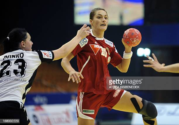 Hungary's Viktoria Redei Soos is pushed by Russia rightback Anna Punko during the 2012 EHF European Women's Handball Championship Group II match of...