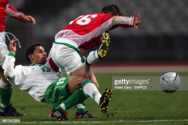 Hungary's Zabolcs Huszti and Saudi Arabia's AL Thaqfy Mansour battle for the ball