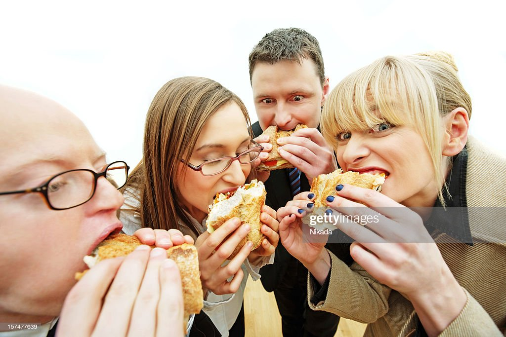 Hungry office workers : Stock Photo