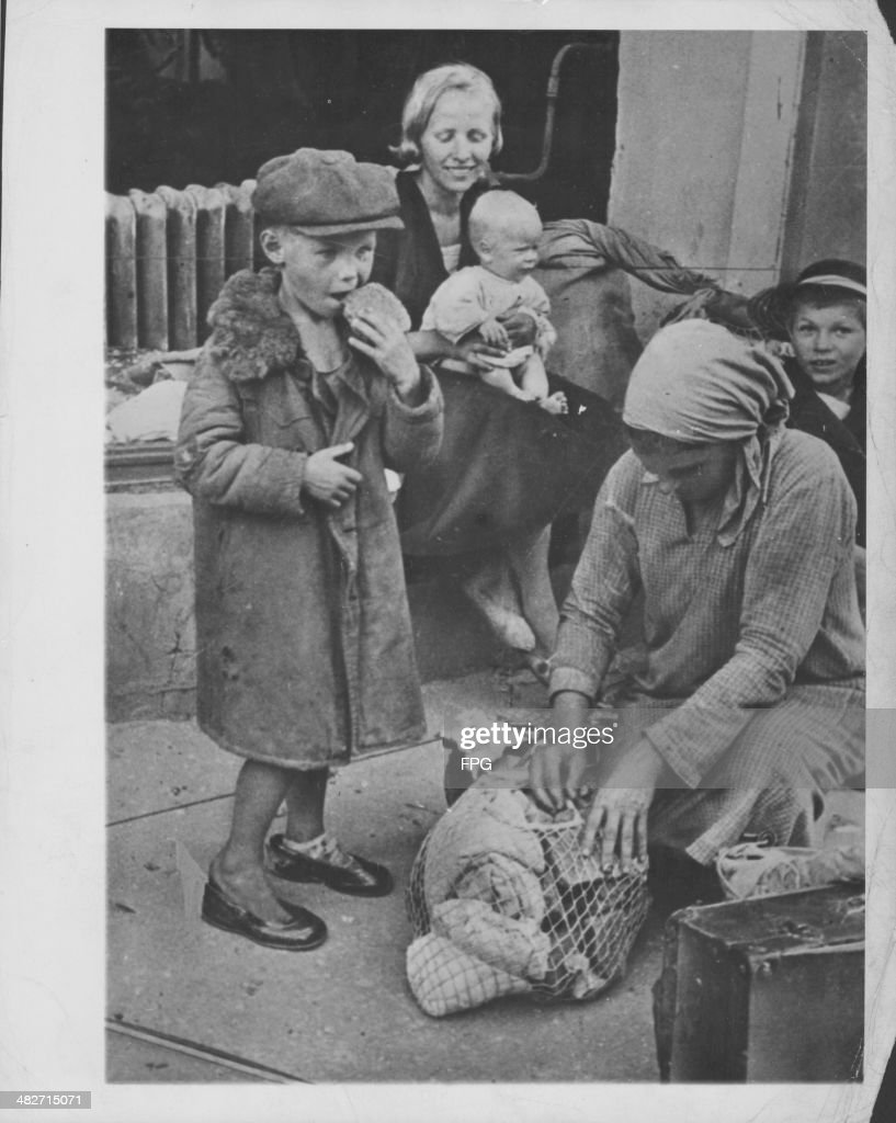 Hungry poverty stricken families on the streets of Smolensk during World War Two Russia circa 19411945