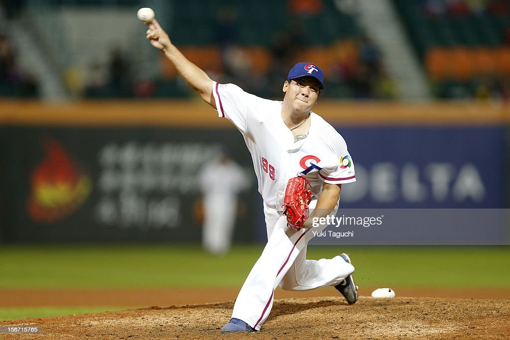 Hung-Wen Chen #99 of Team Chinese Taipei pitches in the bottom of the ninth inning during Game 6 of the 2013 World Baseball Classic Qualifier against Team New Zealand at Xinzhuang Stadium in New Taipei City, Taiwan on Sunday, November 18, 2012.