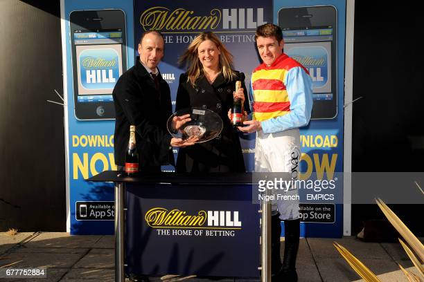 Hunt Ball owner Anthony Knott and jockey Barry Geraghty with the trophy after winning The William Hill App 25 SignUp Bonus Handicap Steeple Chase