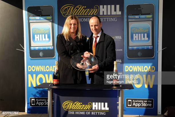 Hunt Ball owner Anthony Knott with the trophy after winning The William Hill App 25 SignUp Bonus Handicap Steeple Chase
