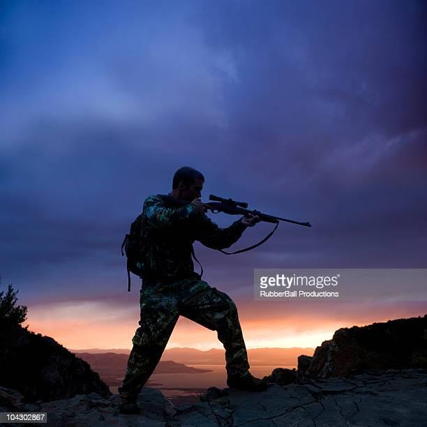hunter against a sunset
