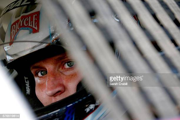Hunter Baize driver of the Bicycle Playing Cards/ Pine Mnt Chevrolet sits in his car during practice for the NASCAR KN Pro Series East United Site...