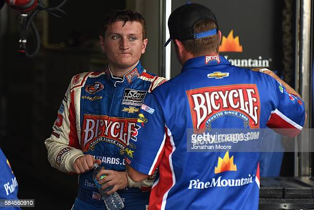 Hunter Baize driver of the Bicycle Playing Cards/Pine Mountain Firelongs Chevrolet in the garage during practice for the NASCAR KN Pro Series Casey's...