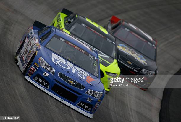 Hunter Baize driver of the Bicycle Playing Cards/Pine Mountain Firelogs Chevrolet leads cars during the NASCAR KN Pro Series East Dover 125 at Dover...