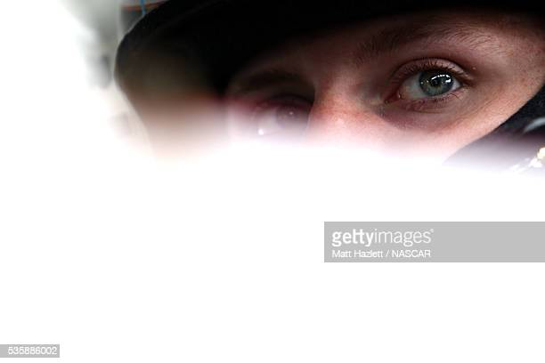 Hunter Baize driver of the Bicycle Playing Cards/Pine Mountain Chevrolet sits in his car during practice for the NASCAR KN Pro Series East ComServe...