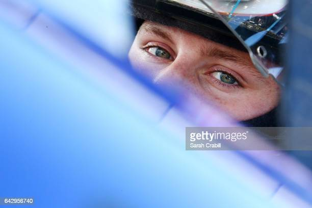 Hunter Baize driver of the EcoWater Systems Naples/KnT Sports Cards Chevrolet sits in his car during practice for the NASCAR KN Pro Series East Jet...