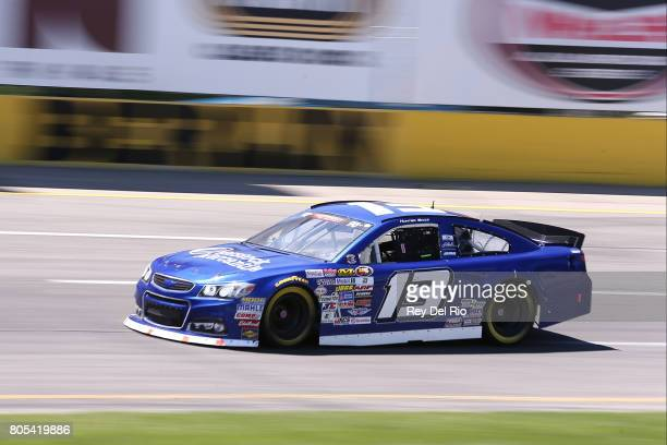 Hunter Baize driver of the EcoWater Systems Naples/KnT Sports Cards Chevrolet during practice for the NASCAR KN Pro Series East Stars Stripes 150 at...