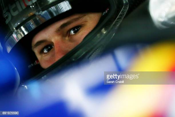 Hunter Baize driver of the Overstock Mercantile Chevrolet sits in his car during practice for the NASCAR KN Pro Series East Memphis 125 presented by...