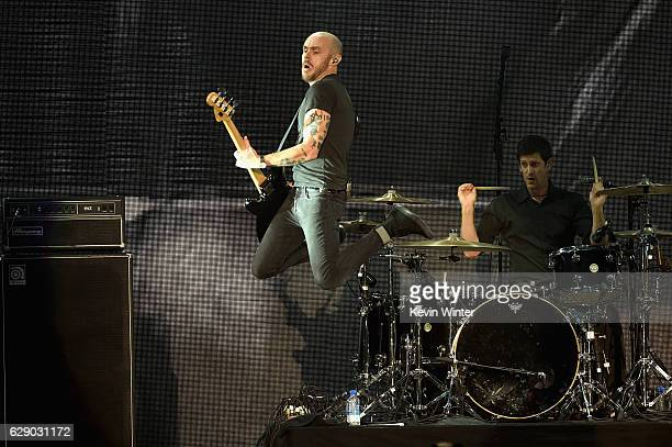 Hunter Burgan left and Adam Carson of the band AFI perform onstage at 1067 KROQ Almost Acoustic Christmas 2016 Night 1 at The Forum on December 10...