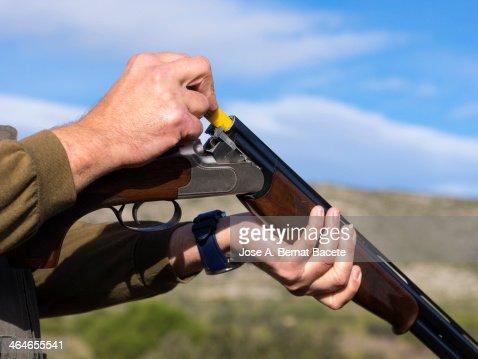 Hunter carrying a shotgun