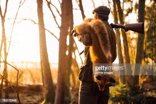Hunter carrying fox
