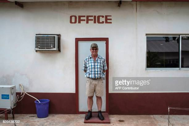 Hunter Coetzee abattoir manager of Valentine Chicken Hunter Coetzee poses for a photo on on July 11 2017 Farming in Nigeria is not for the...