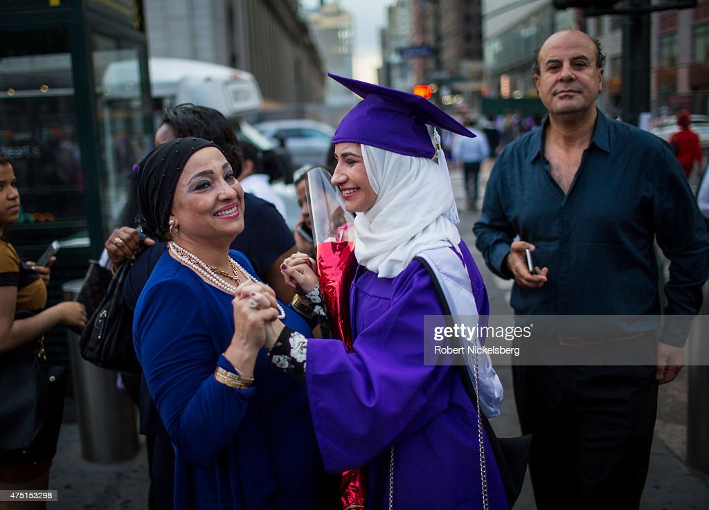 Hunter College graduate Dania Darwish, center, stands between her parents following graduation ceremonies held at Madison Square Garden May 27, 2015 in New York City. Dania, a first generation Syrian-American, has been accepted into a masters degree program at three schools in England: Oxford, University of London and the London School of Economics. She plans to pursue a career in law or diplomacy.
