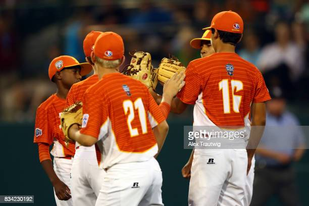 Hunter Ditsworth of the Southwest team from Texas is met by his teammates on the mound during Game 4 of the 2017 Little League World Series against...