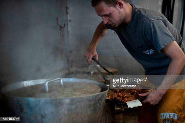 Hunter Fredlund prepares a tray of crabs at Cantler's Riverside Inn June 28 2017 in Annapolis Maryland A unique multimillion dollar industry crab...