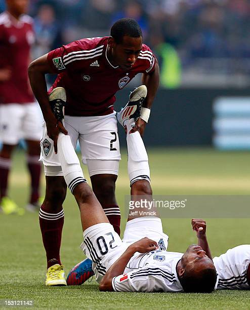 Hunter Freeman of the Colorado Rapids helps Dane Richards of the Vancouver Whitecaps FC regain his breath after a collision during their MLS game...