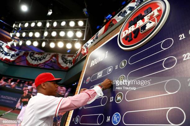Hunter Greene puts his name card on the draft board after being selected by the Cincinnati Reds during the 2017 Major League Baseball Draft at Studio...