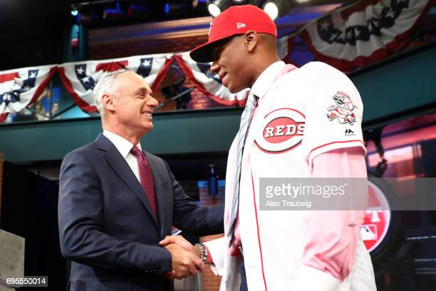 Hunter Greene shakes hands with Major League Baseball Commissioner Robert D Manfred after being selected second overall by the Cincinnati Reds during...