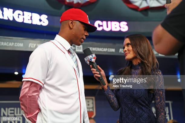 Hunter Greene talks to Sam Ryan after being selected by the Cincinnati Reds during the 2017 Major League Baseball Draft at Studio 42 at the MLB...