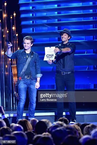 Hunter Hayes and Jason Mraz speak onstage during the 47th annual CMA awards at the Bridgestone Arena on November 6 2013 in Nashville United States