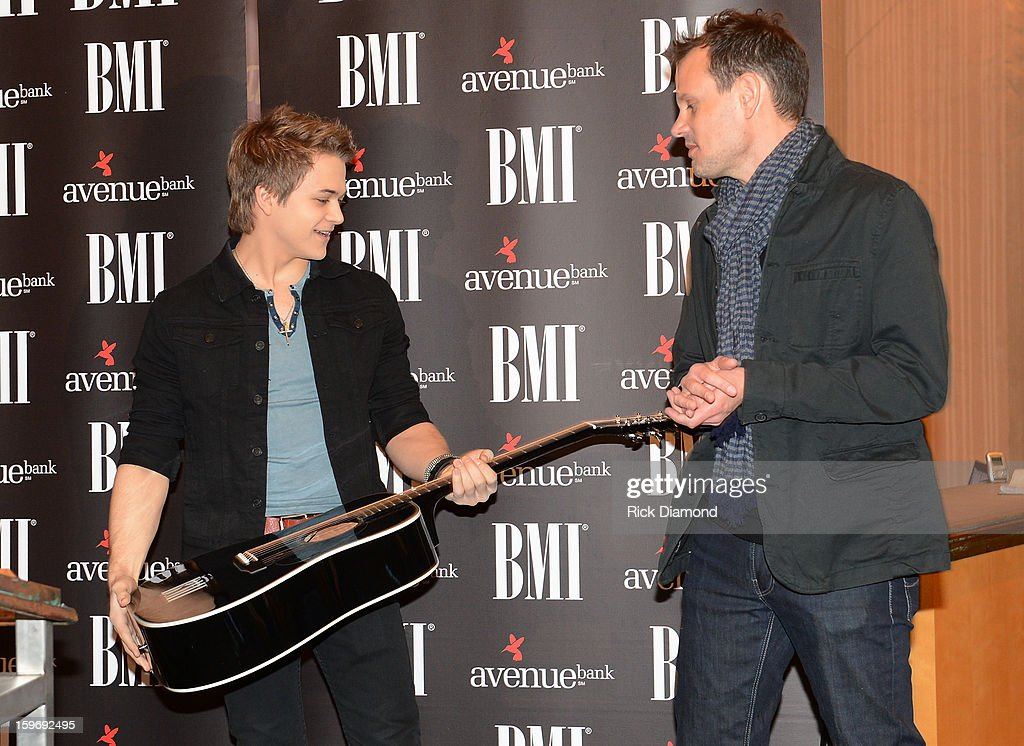 Hunter Hayes cowriter receives a guitar from BMI and Troy Verges cowriter attend the 'Wanted' No 1 Party on January 17 2013 in Nashville Tennessee