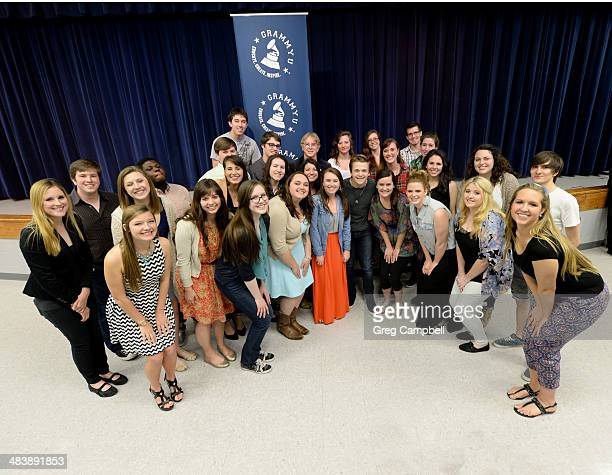 Hunter Hayes poses with students from the Memphis Chapter of the GRAMMY U at Lewisburg High School on April 10 2014 in Olive Branch Mississippi