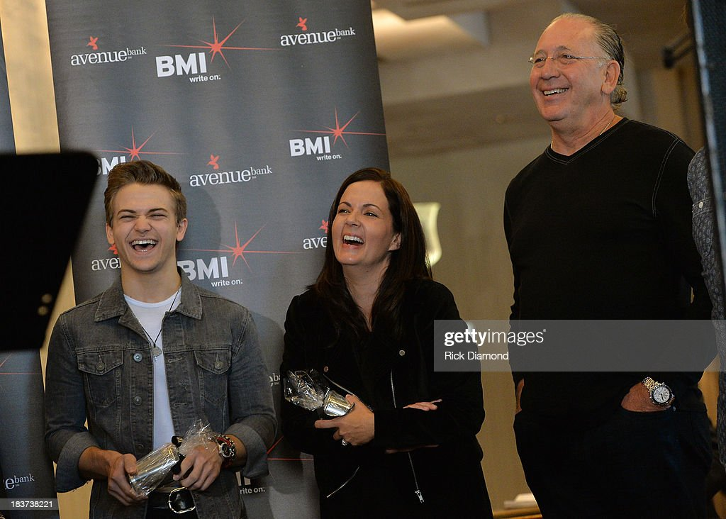 <a gi-track='captionPersonalityLinkClicked' href=/galleries/search?phrase=Hunter+Hayes&family=editorial&specificpeople=3290701 ng-click='$event.stopPropagation()'>Hunter Hayes</a> with co-writers Lori McKenna and Warner Music Nashvilles John Esposito attend the BMI and <a gi-track='captionPersonalityLinkClicked' href=/galleries/search?phrase=Hunter+Hayes&family=editorial&specificpeople=3290701 ng-click='$event.stopPropagation()'>Hunter Hayes</a> Celebration of the No. 1 Song 'I Want Crazy' at BMI offices In Nashville on October 8, 2013 in Nashville, Tennessee.