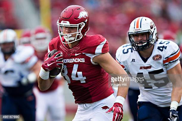 Hunter Henry of the Arkansas Razorbacks runs the ball after catching a pass during a game against the UT Martin Skyhawks at Razorback Stadium on...