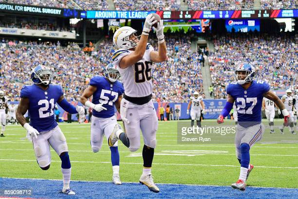 Hunter Henry of the Los Angeles Chargers catches a third quarter touchdown pass against Landon Collins Keenan Robinson and Darian Thompson of the New...