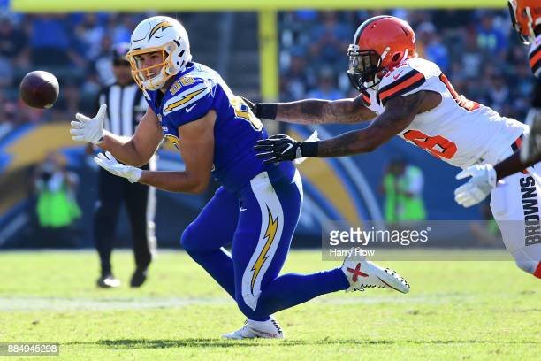 Hunter Henry of the Los Angeles Chargers makes the catch in front of Christian Kirksey of the Cleveland Browns for a first down during the first...
