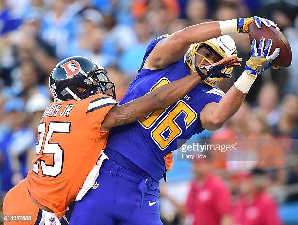 Hunter Henry of the San Diego Chargers makes a catch for a touchdown in front of Chris Harris of the Denver Broncos to take a 70 lead during the...