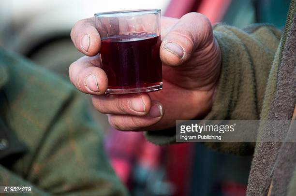 Hunter holding red wine glass